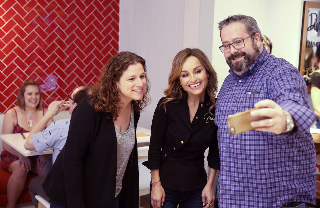 Giada De Laurentiis, center, visits with Jodie and Mark Silberman of Chicago at the start of Ap ...