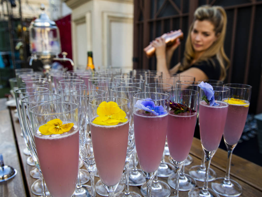 Mixologist Barrie Webster works to create a High Pollen Countess cocktail during a Vegas Uncork ...