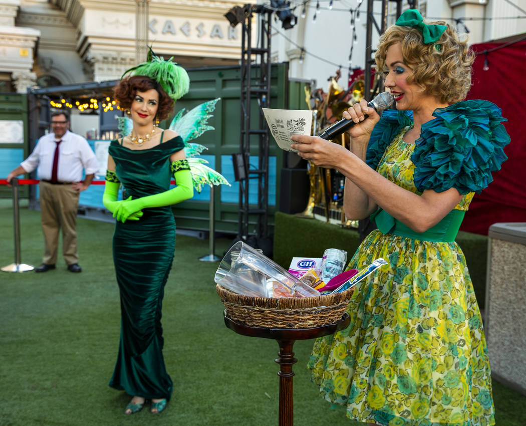 The Green Fairy looks to Wanda Widdles as she readies to create her own cocktail for guests dur ...