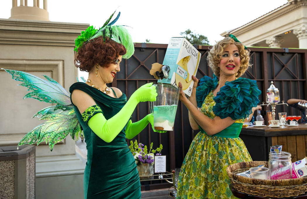 The Green Fairy assists Wanda Widdles as she creates her own cocktail for guests during a Vegas ...