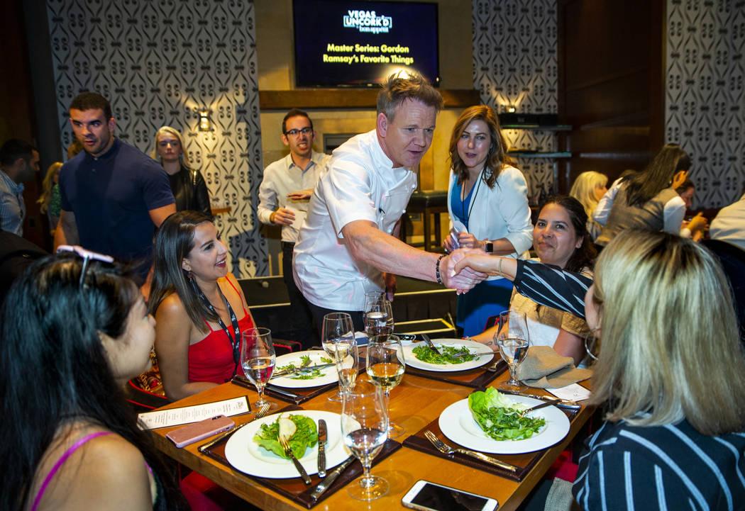 Chef Gordon Ramsay greets diners, from left, Jenn Tanaka, Shadia Asencio, Issa Plancarte and Gi ...