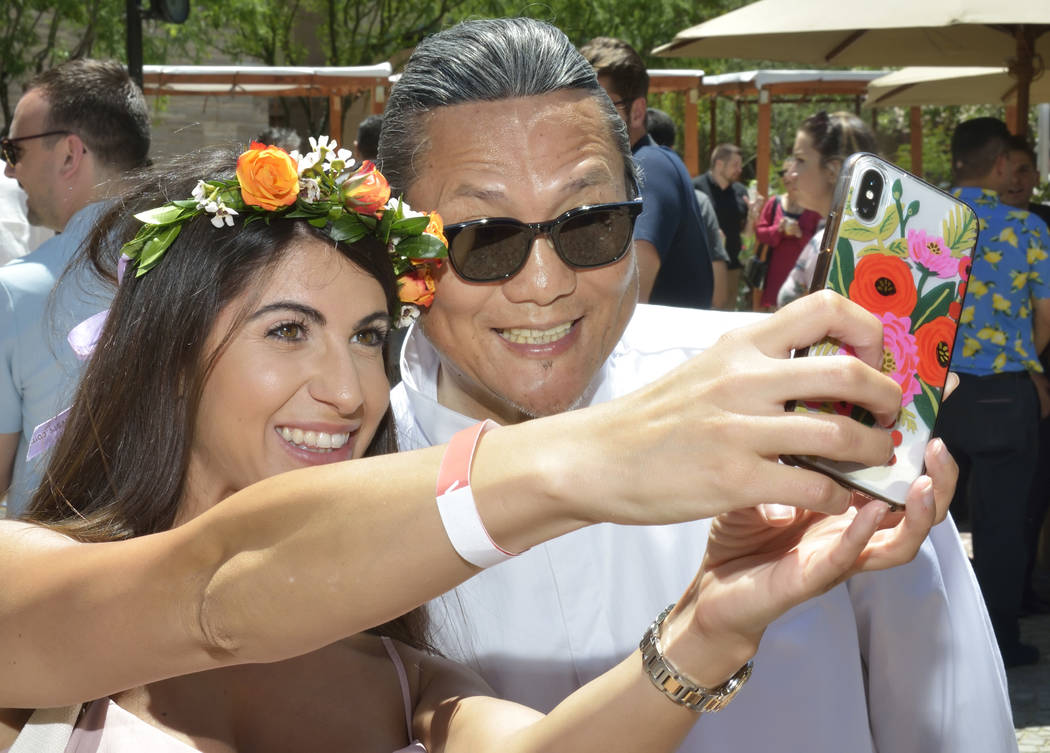 Domenica Danna takes a selfie with chef Masaharu Morimoto during Picnic in the Park at the Park ...