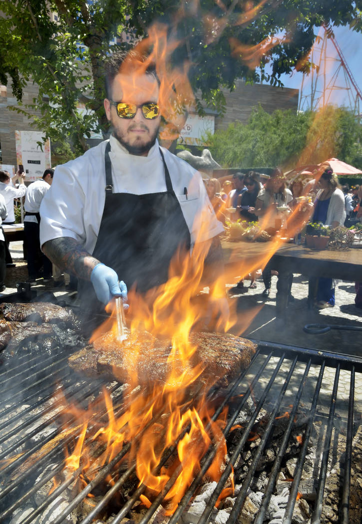 Chef Ryan Derieux of Voltaggio Brothers Steak House MGM National Harbor, cooks short ribs durin ...