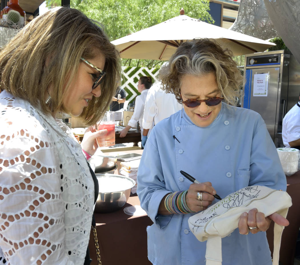 Chef Susan Feniger of Border Grill, right, autographs a bag for Adelina Badalyan during Picnic ...