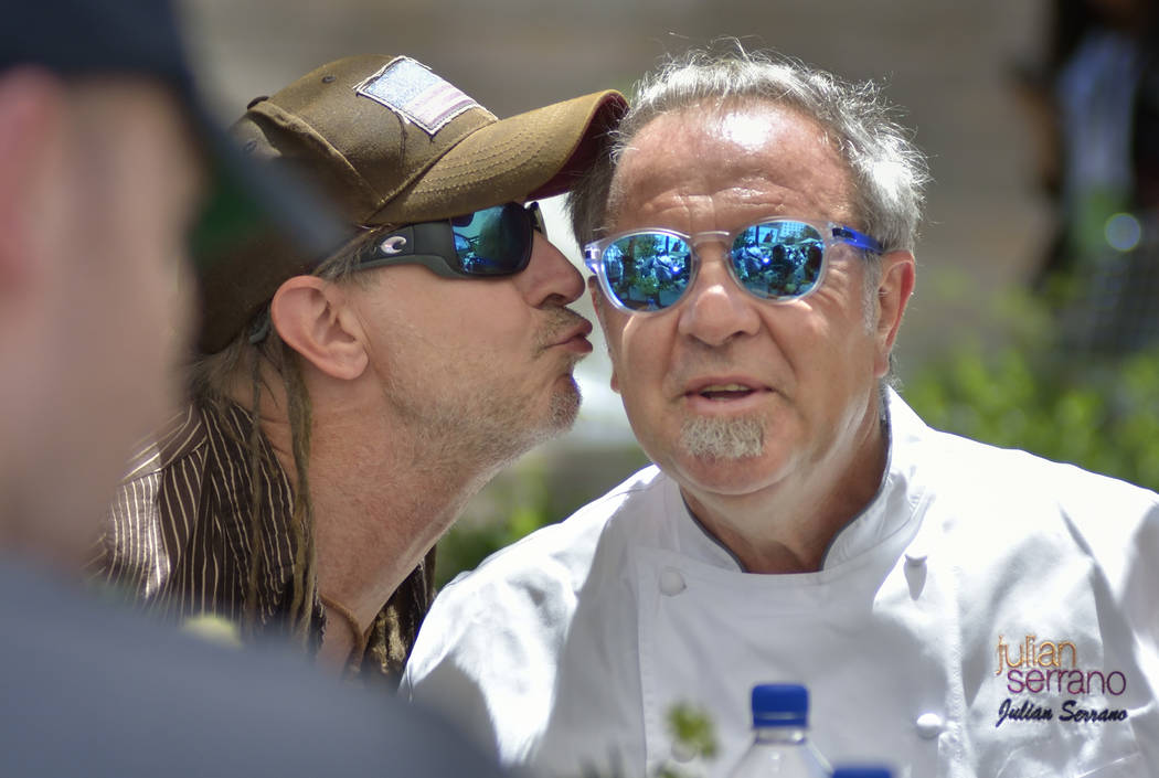 Chef Julian Serrano, right, gets a kiss from Andrea Boccardi during Picnic in the Park at the P ...