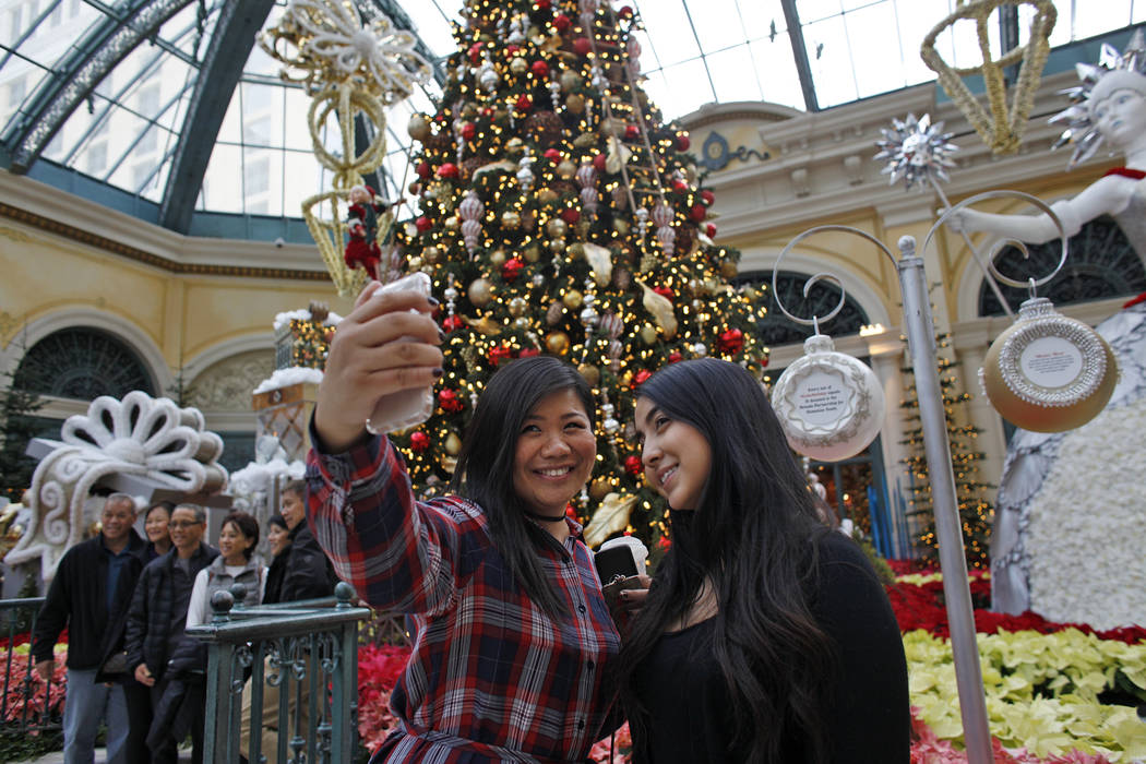 Shu Pan, left, and Michelle Leon take a selfie at the Bellagio Conservatory & Botanical Gar ...