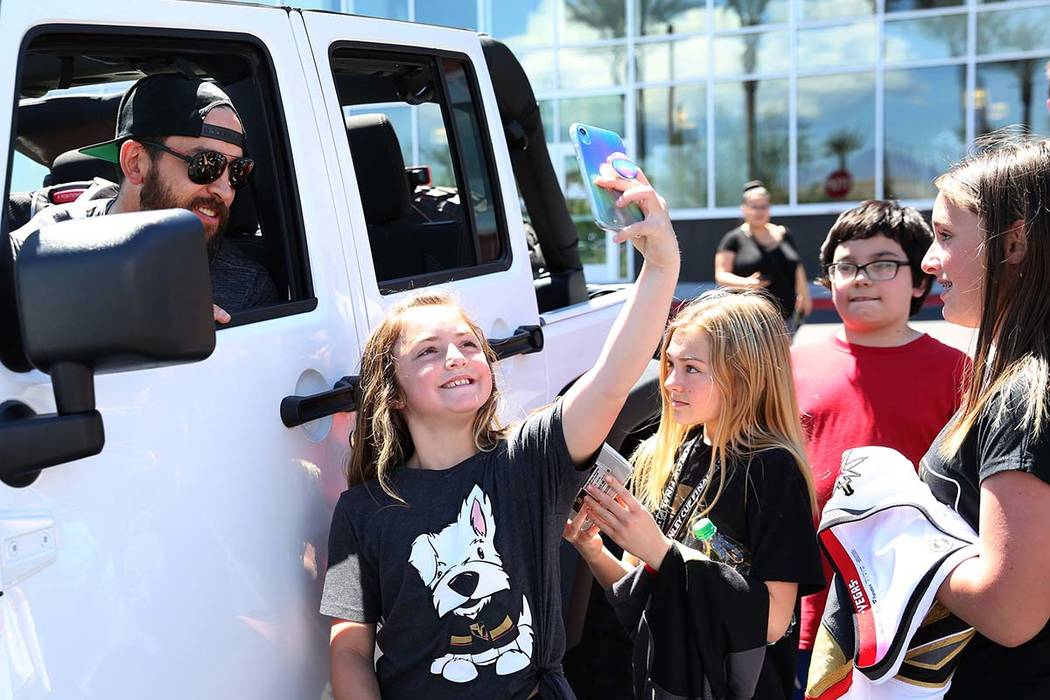 Golden Knights defenseman Deryk Engelland poses for a selfie with fans outside City National Ar ...