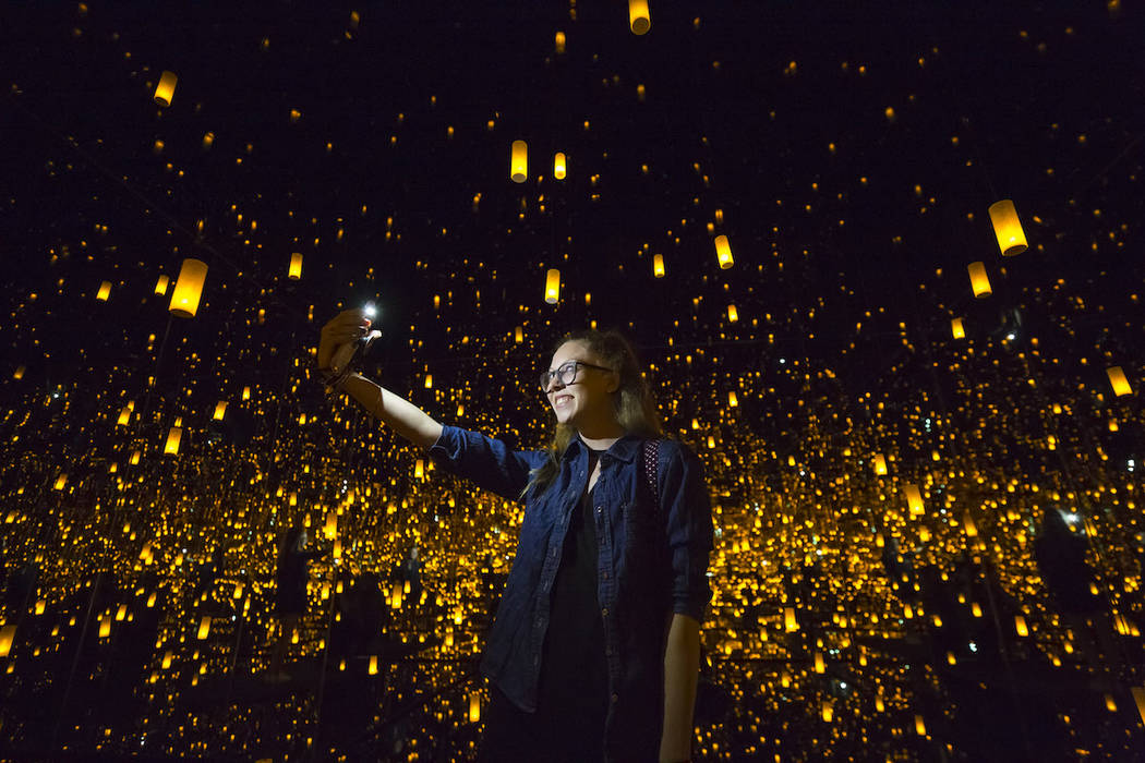 Kate Rosen, 25, of California snaps a selfie inside Yayoi Kusama's Infinity Mirrored Room at th ...