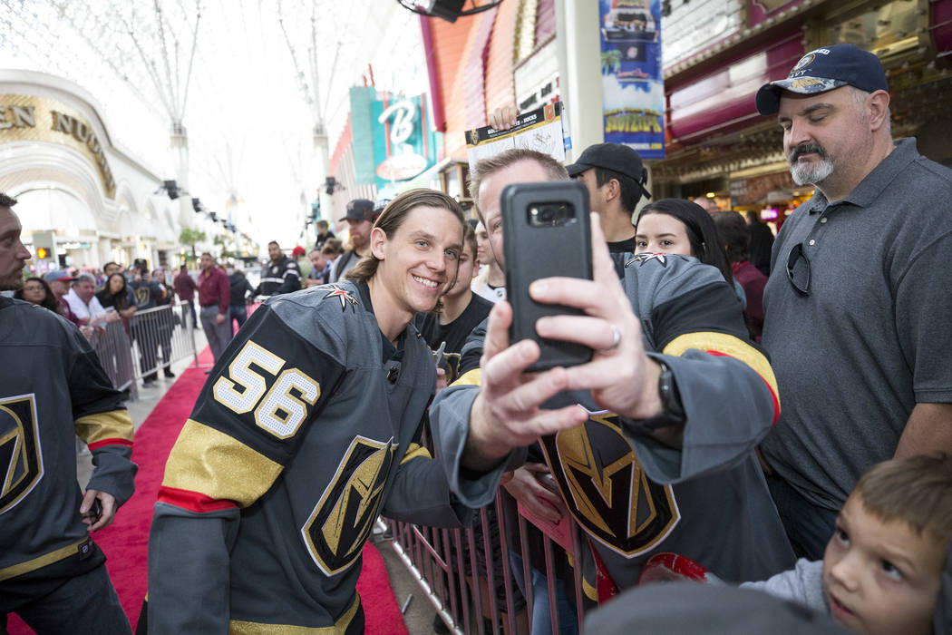 Vegas Golden Knights left wing Erik Haula (56) poses with fans during the team's first fan fest ...