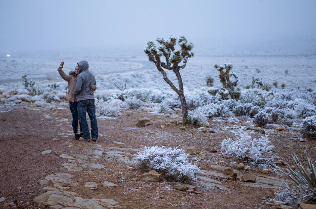 Candace Reid, of Albuquerque, N.M., left, takes a selfie with James Minner, of Las Vegas, as sn ...