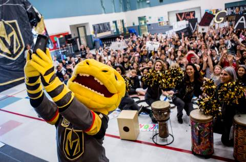 Vegas Golden Knights mascot Chance the Gila monster takes a selfie with the crowd during a Gold ...