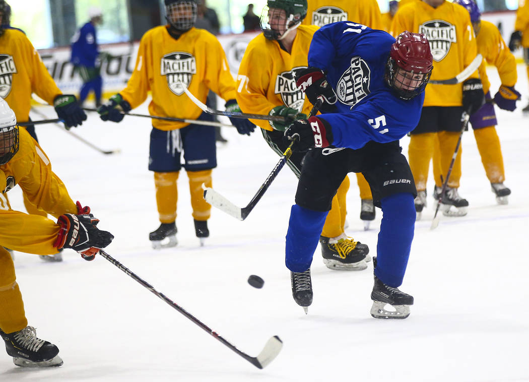 Team Blue's Matthew Gross (51) shoots against Team Yellow during a game in the USA Hockey Pacif ...