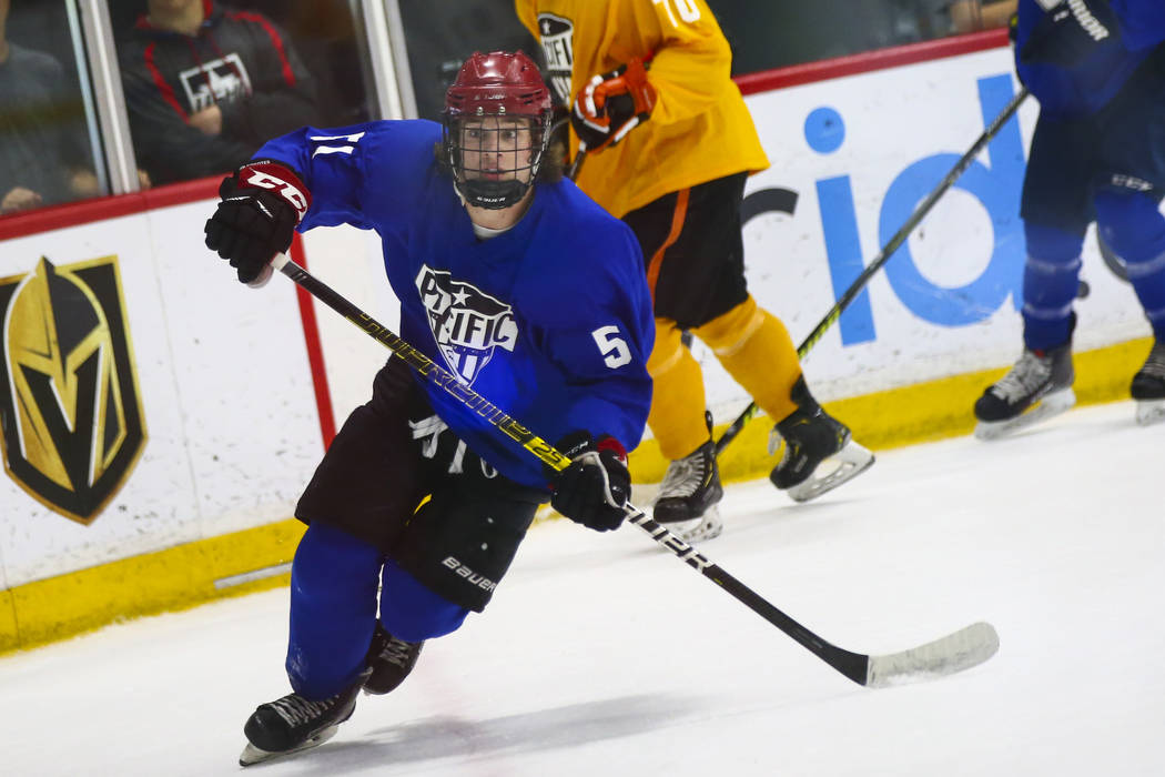 Team Blue's Matthew Gross (51) chases after the puck against Team Yellow during a game in the U ...