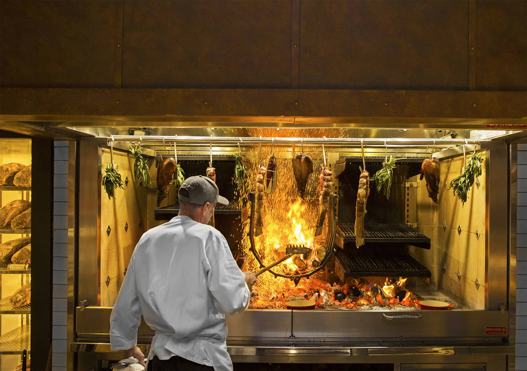 Master cook Scott Brown cooks on the open-hearth fire at Eataly on Wednesday, Feb. 6, 2019, at ...