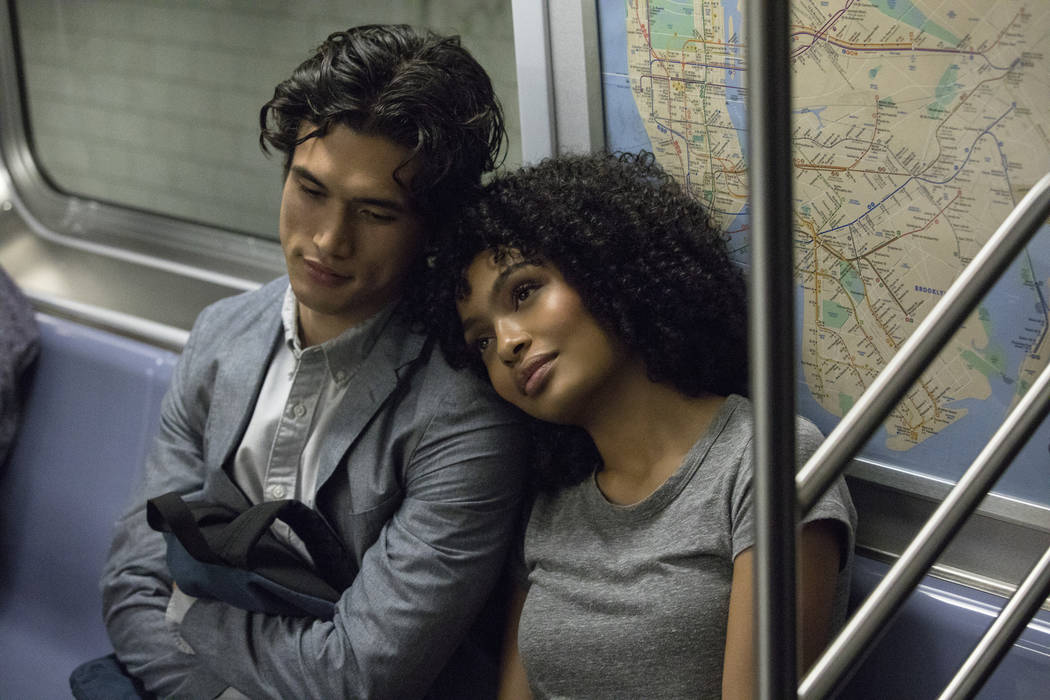 In this image released by Warner Bros. Pictures, Charles Melton, left, and Yara Shahidi appear ...