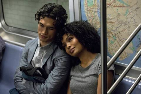 "Charles Melton, left, and Yara Shahidi appear in a scene from the film ""The Sun Is Also a Sta ..."