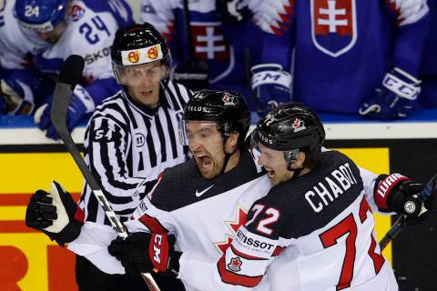 Canada's Mark Stone, left, celebrates with Canada's Thomas Chabot, right, after scoring his sid ...