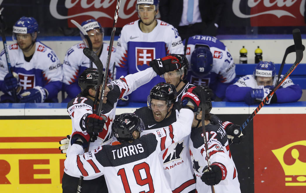 Canada's Mark Stone, center, celebrates with teammates after scoring his side's sixth goal duri ...