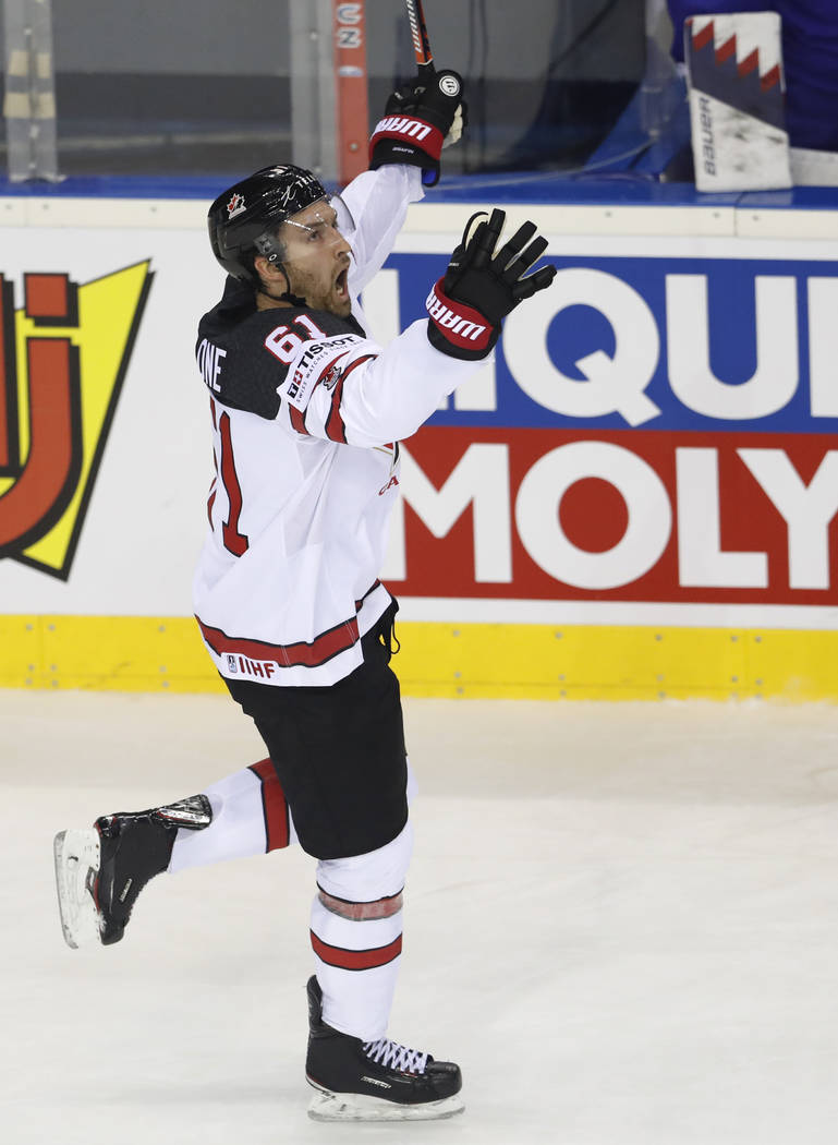 Canada's Mark Stone celebrates with after scoring his side's sixth goal during the Ice Hockey W ...