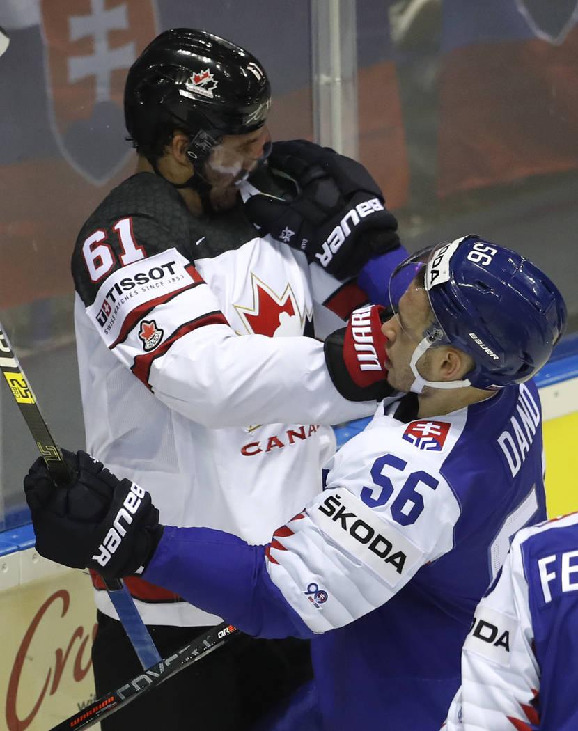 Slovakia's Marko Dano, right, punches Canada's Mark Stone, left, during the Ice Hockey World Ch ...