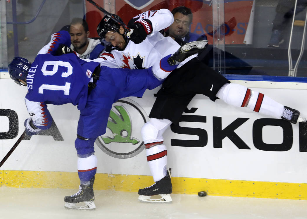 Slovakia's Matus Sukel, left, collides with Canada's Mark Stone, right, during the Ice Hockey W ...