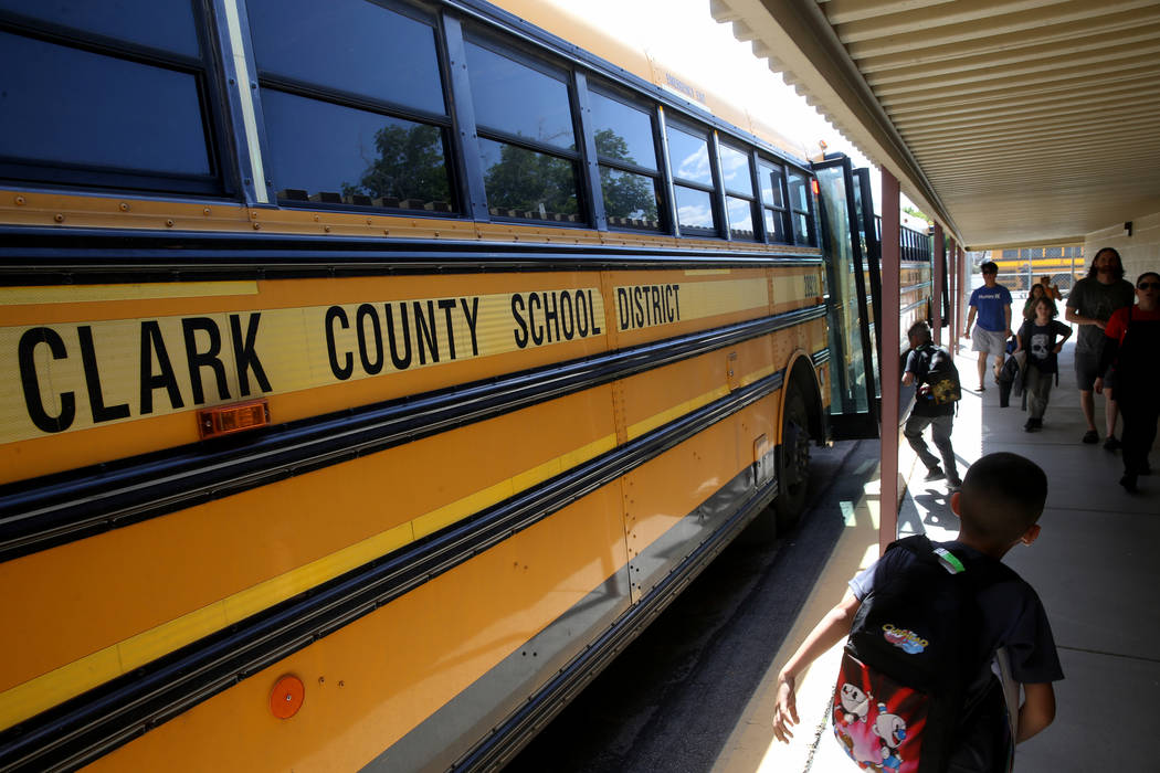 Students at Hoggard Elementary School in Las Vegas get on the bus Monday, May 13, 2019. (K.M. C ...