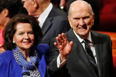 President Russell M. Nelson and his wife Wendy, wave as they leave the morning session of a twi ...