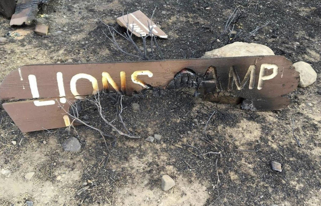 This October 2018 photo provided by the Elko Lion's Club, shows a charred sign at the Lion's Cl ...