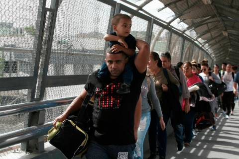 Cuban migrants are escorted by Mexican immigration officials in Ciudad Juarez, Mexico, as they ...