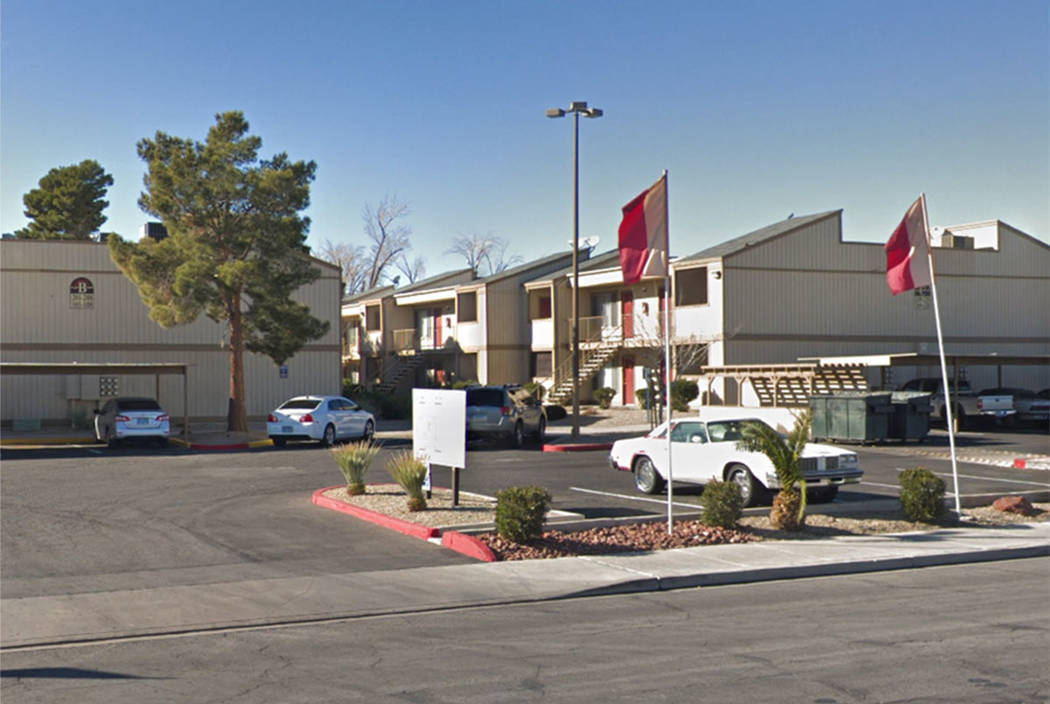 Police investigate the scene at Sunset Terrace apartment complex, at 2855 N. Walnut Road, in La ...