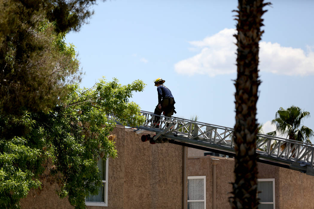 Firefighters respond to a two-alarm fire Monday morning, May 13, 2019 at an apartment building ...