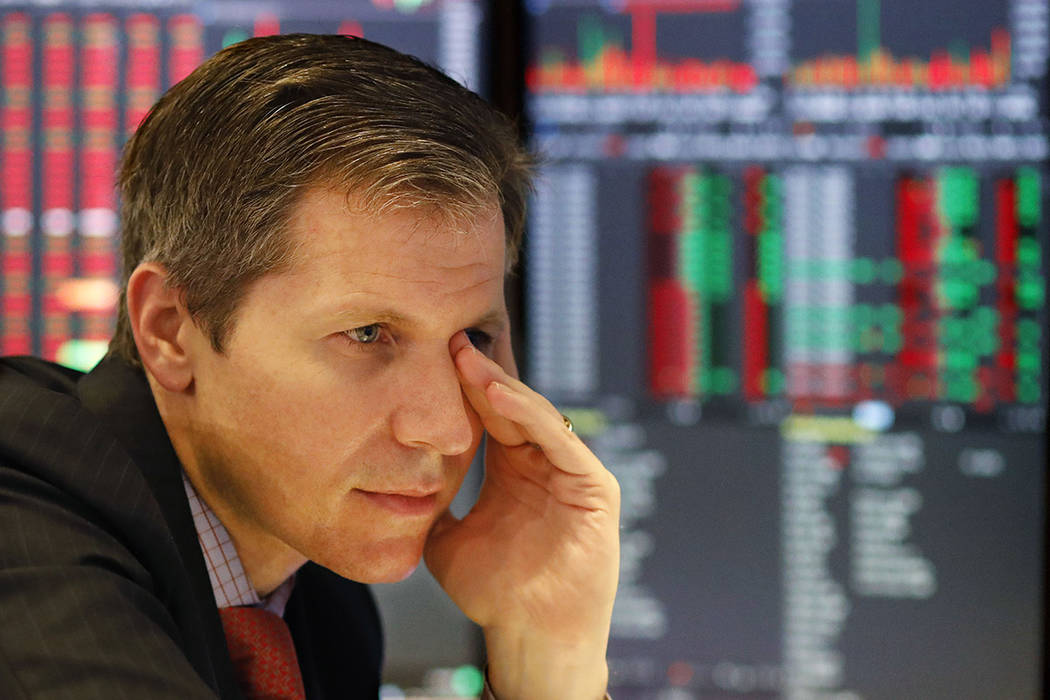 Market maker Thomas Brown follows stock prices at the New York Stock Exchange, Monday, May 13, ...