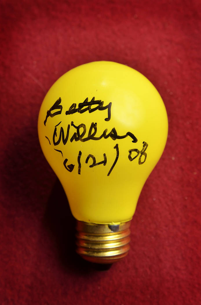"""A light bulb from the """"Welcome to Fabulous Las Vegas Nevada"""" sign which was autographed by Bett ..."""
