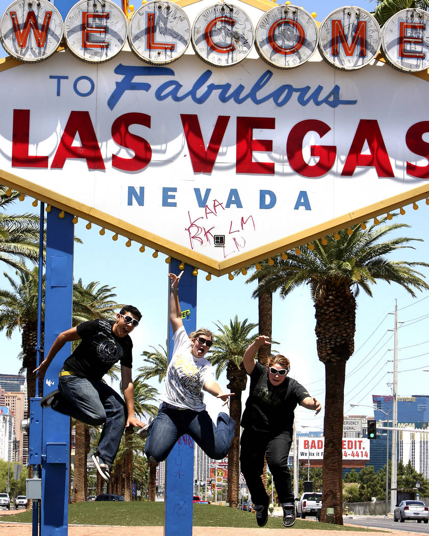 Tourists from Arizona, from left, Joseph Harris, Laura Massengale and Emily Viramontes, all age ...