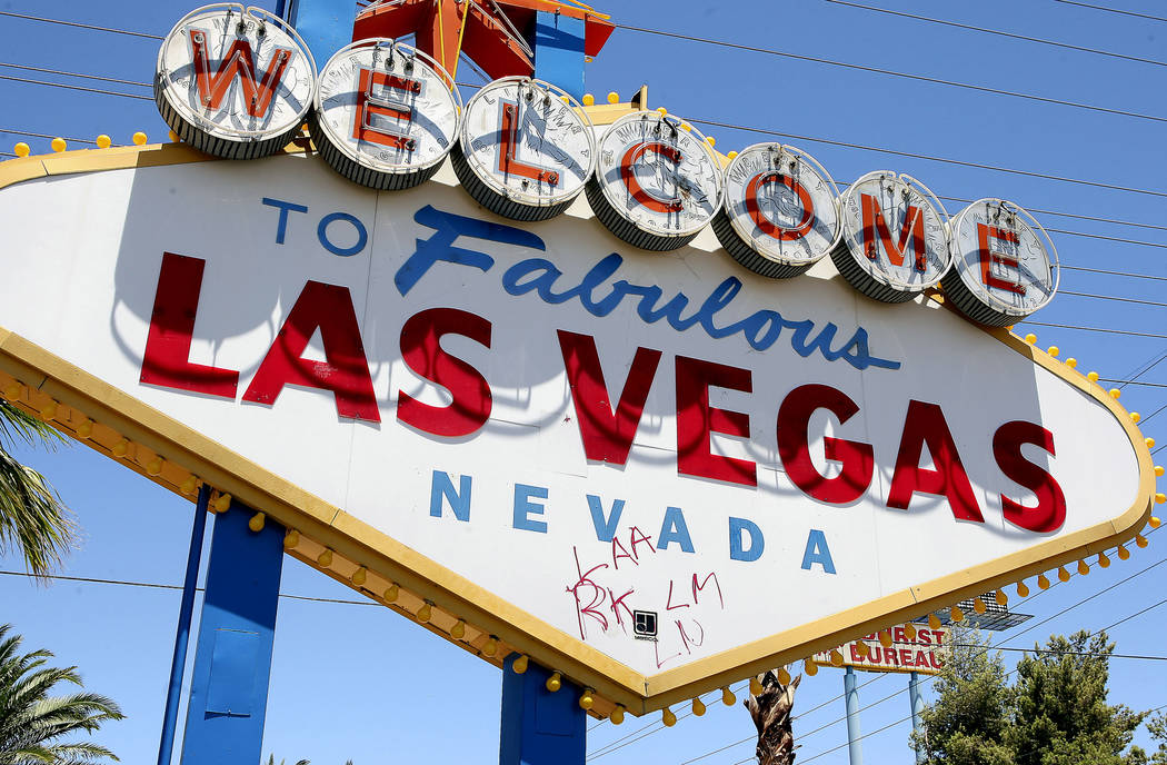 "Graffiti blemishes the ""Welcome To Fabulous Las Vegas Nevada"" sign on Las Vegas Boulevard Monda ..."