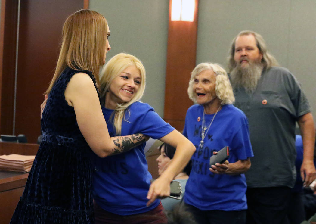 Former Attorney Alexis Plunkett, left, congradulated by supporters, who declined to give their ...