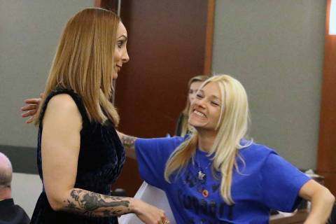 Suspended attorney Alexis Plunkett, left, is congratulated by a supporter, who declined to give ...