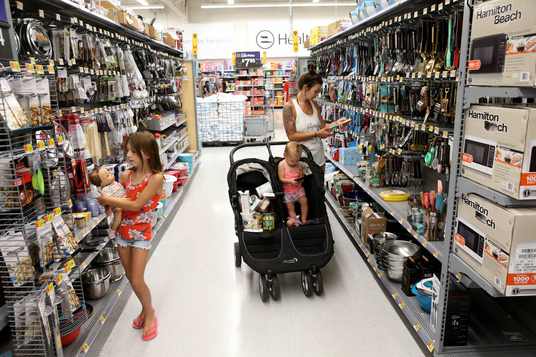 Carly Bush and her children Makenna, 9, and Liberty, 2, of Las Vegas, shop at Walmart at 2310 E ...