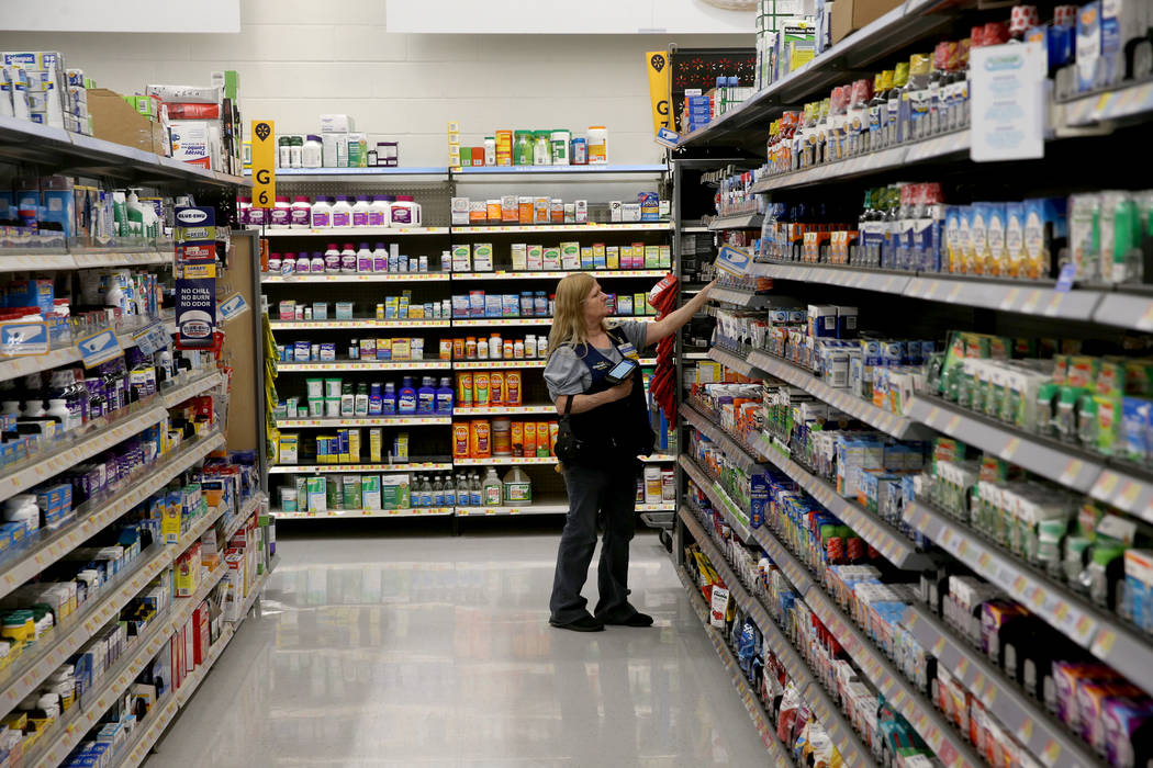 Health and Beauty Department Manager Jeanne Reed scans items at Walmart at 2310 E. Serene Ave. ...