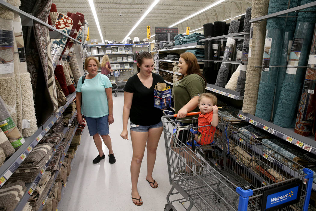 Brittanee Bradley, second from left, shops with her son Daymon 1, mother Kim Debusk, right, and ...