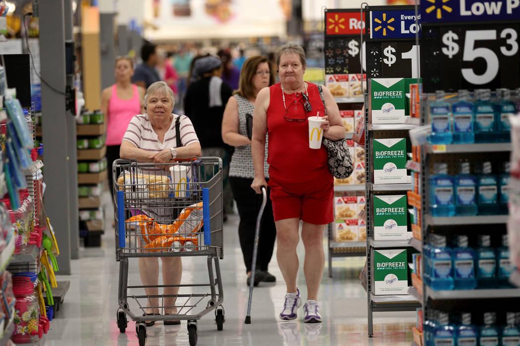 Helga Beltan, left, and Helen Wilson shop at Walmart at 2310 E. Serene Ave. in Las Vegas Tuesda ...