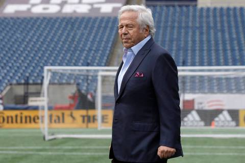 New England Patriots owner Robert Kraft steps onto a podium before introducing first-round NFL ...