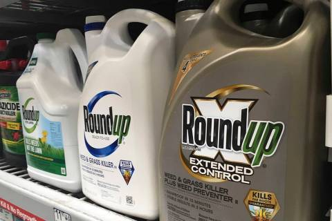 FILE - In this Feb. 24, 2019, file photo, containers of Roundup are displayed on a store shelf ...