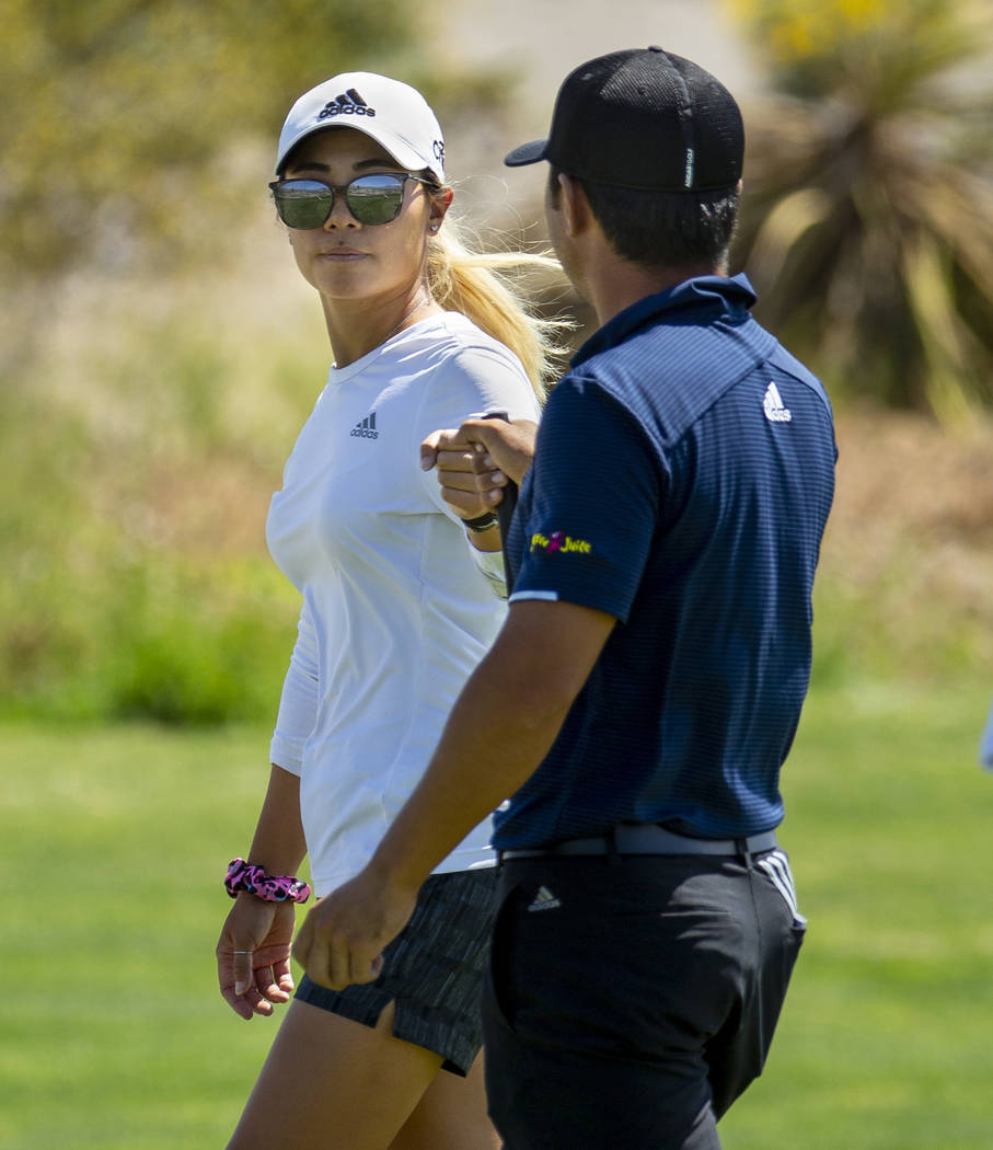 LPGA golfer and caddy Danielle Kang congratulates her brother Alexander Kang on another great s ...