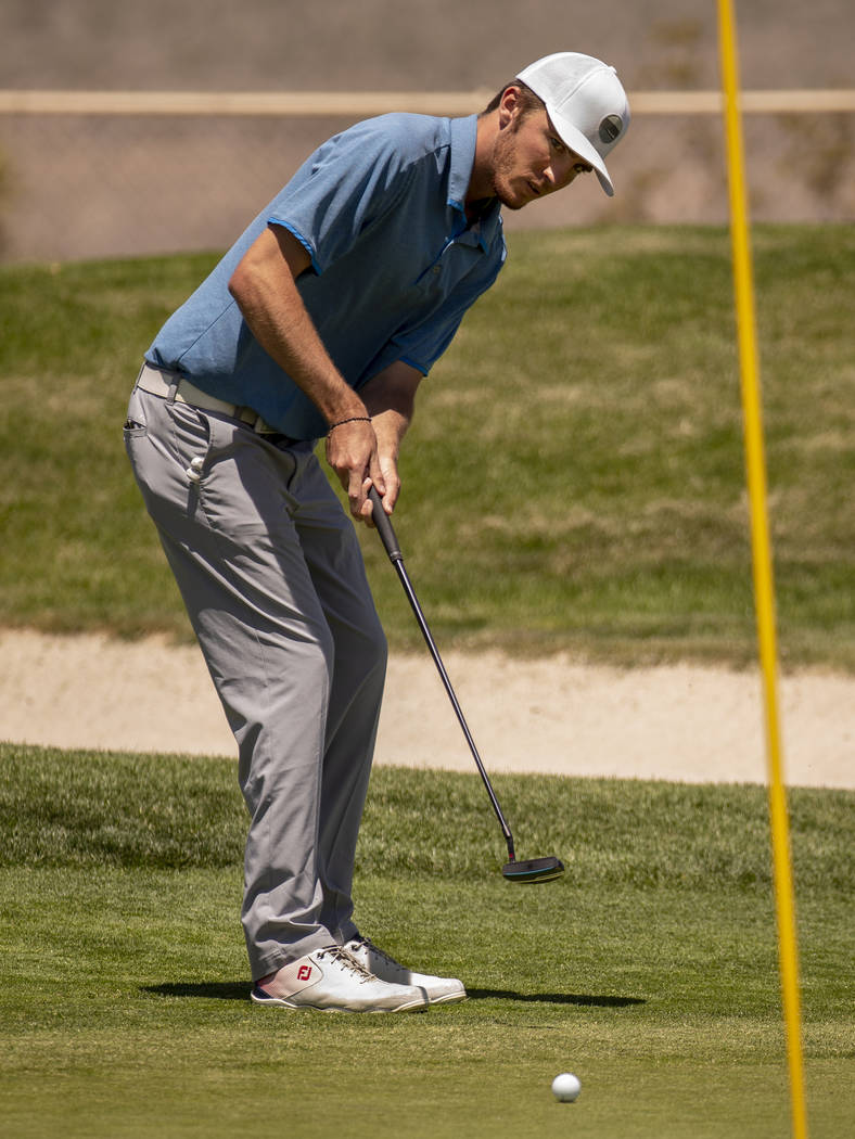 Golfer Van Thomas eyes a ball on the way to the hole during a PGA US Open qualifying round at t ...