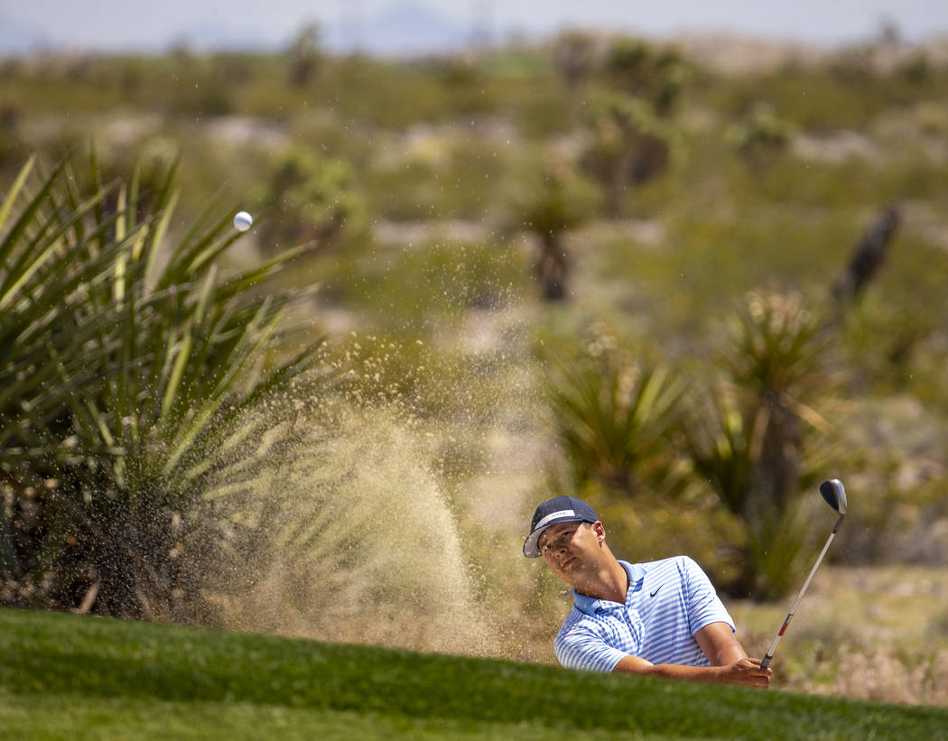 Golfer Shane Crampton blasts a ball out of a sand trap during a PGA US Open qualifying round at ...