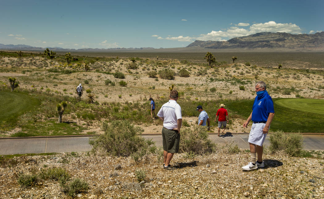 Golfers and others help to look for a lost ball off the fairway during a PGA US Open qualifying ...