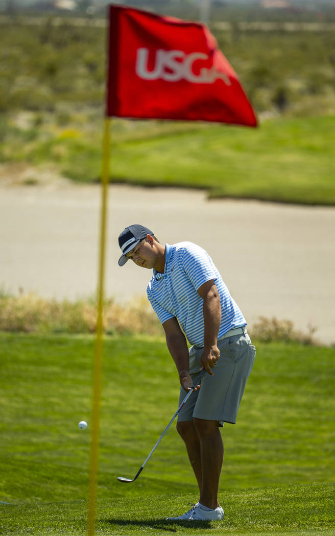 Golfer Shane Crampton chips a ball towards the stick during a PGA US Open qualifying round at t ...