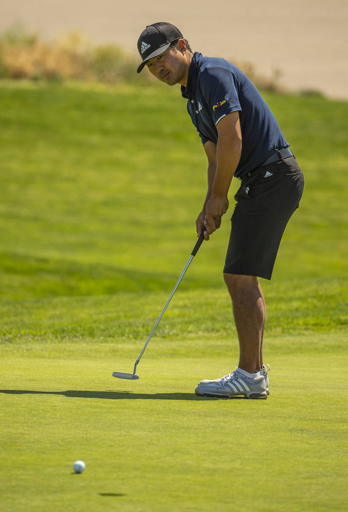 Golfer Alexander Kang looks a putt all the way in during a PGA US Open qualifying round at the ...