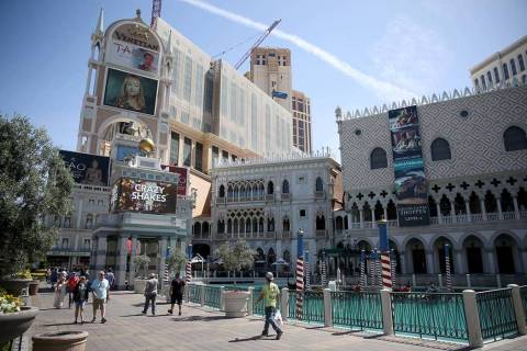 Portraits of founding employees are displayed on The Venetian marquee to celebrate the 20th ann ...